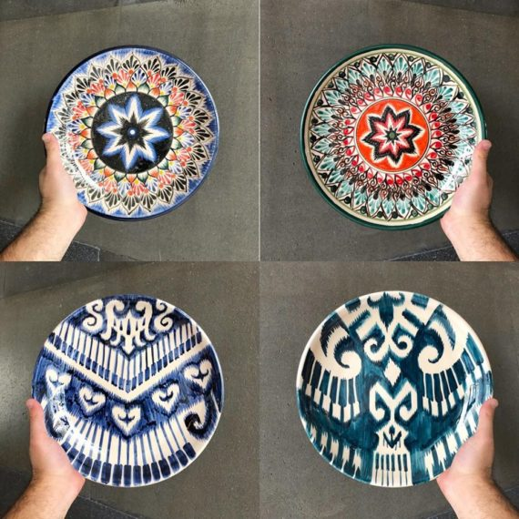 Glazed ceramic plates of hand-painted with national patterns